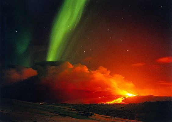 What a sight:) Aurora Borealis over an erupting volcano