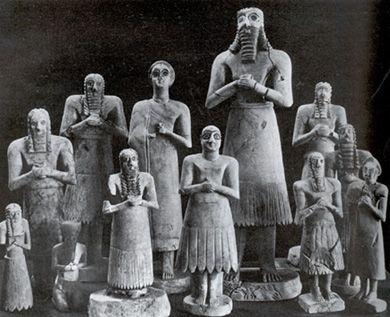 """SUMERIAN ART: Statues from the Abu Temple c. 2700 - 2500 B.C. Stone sculptures of deities. Tallest is 30"""" high. Colored inlayed eyes. Bodies and faces simplified in order to avoid distracting attention from eyes. Arms and legs have roundness of pipes. Frontal, rigid and symmetrical like Egyptian art. LOCATION: IRAQ MUSEUM, BAGHDAD & THE ORIENTAL INSTITUTE, THE UNIVERSITY OF CHICAGO"""