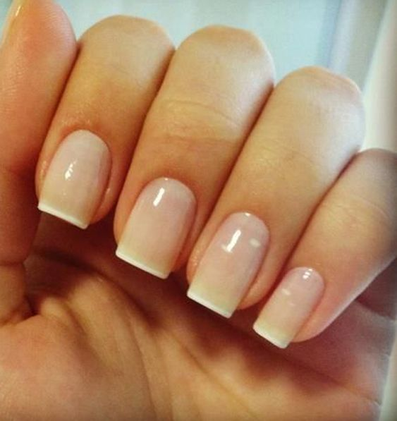 Simple, neat and tidy. Some people like to keep it simple and this nude and French tip nail art design is the epitome of minimalism and beauty.