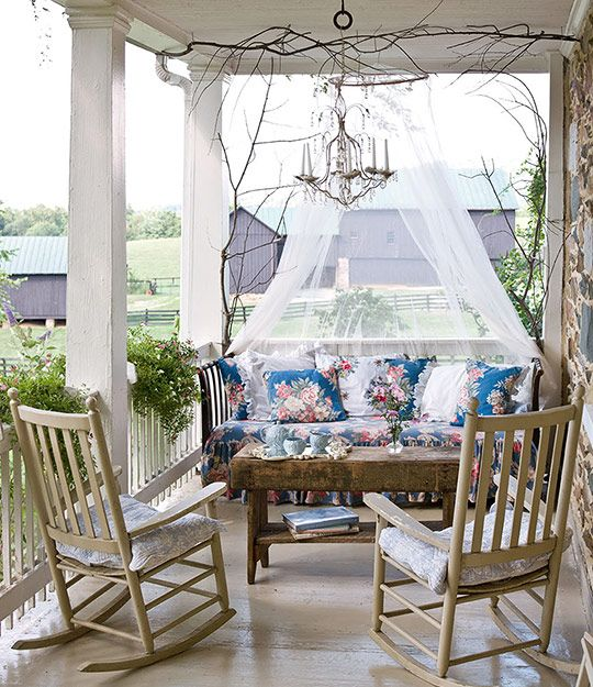 A daybed, table and chairs make this porch the perfect  outdoor living room. I could curl up and read a book on that daybed! Photo: Helen Norman: