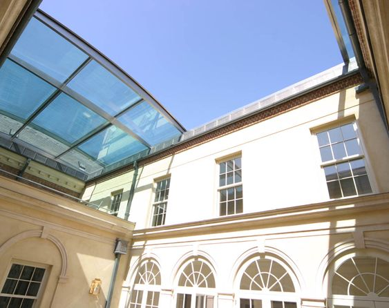 A Massive Bi Parting Retractable Roof Over The 100m² Courtyard Of A Listed  Building. Vast Pieces Of Glass Are Set Onto A Gently Arched Frame. 14.5mu2026