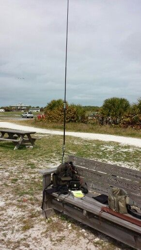 Icom IC703 and backpack with Buddistick antenna on Honeymoon Island State Park, Florida.