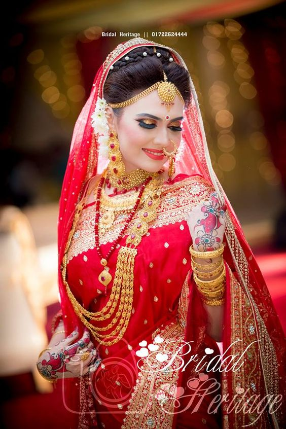 Bengali bride! One day, I'll be dressed like this! Well, maybe with more color, but yeah. Can't wait till I get married!