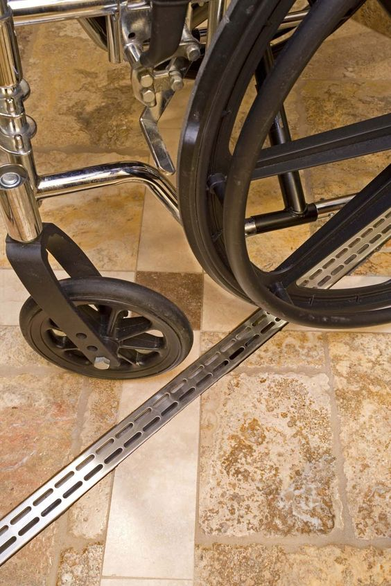 For Universal Design - Trench drain catches water before it comes out of roll in showers. And they look great! Shared by @Feia Construction, LLC - Susie FeiaConstruction, LLC - Susie Feia: