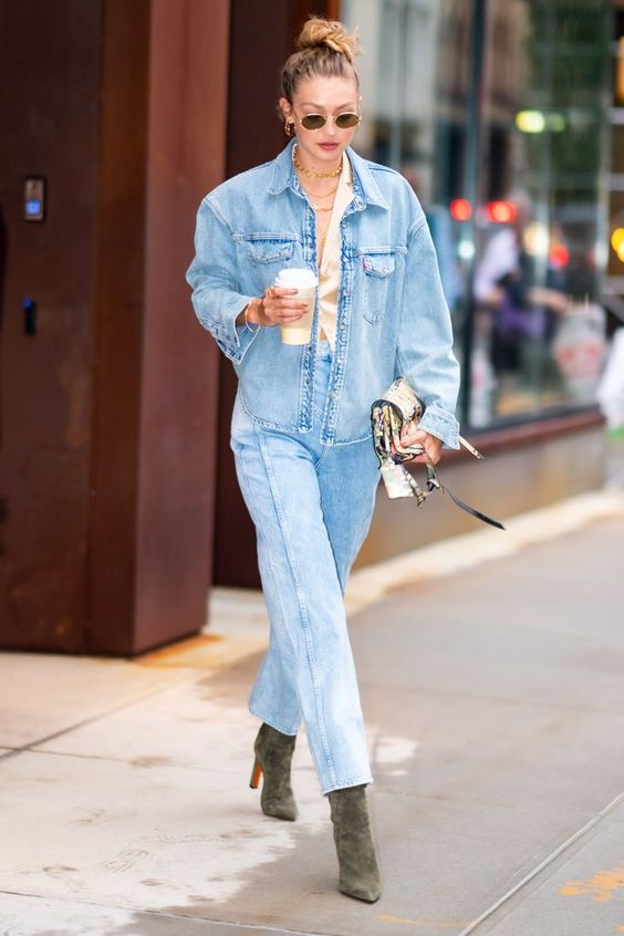 Gigi Hadid wears green suede boots with a Canadian tuxedo in August 2019 at the US Open. #gigihadid #celebrityfashion #christianlouboutin #canadiantuxedo