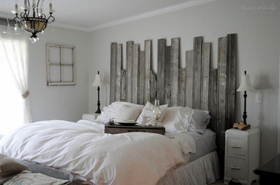 For a fun and easy DIY project, grab some reclaimed wood boards of varying lengths and put together a unique rustic headboard for your bed.