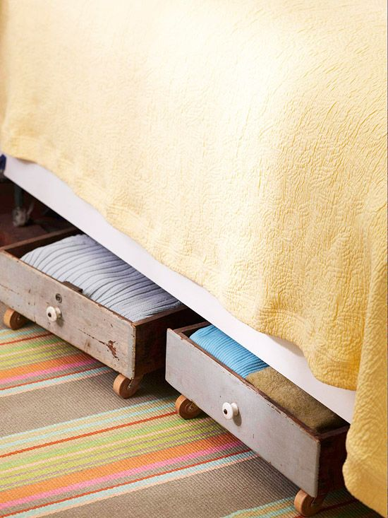Old drawers with wheels -- easy under bed storage.