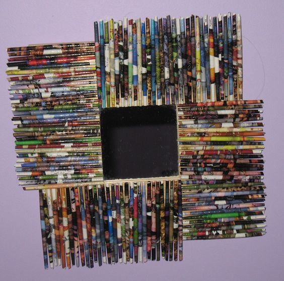 For my daughter's room... a cheap wooden Ikea mirror, covered in handmade paper beads rolled from the glossy pages of my National Geographic collection.  Modge Podge.