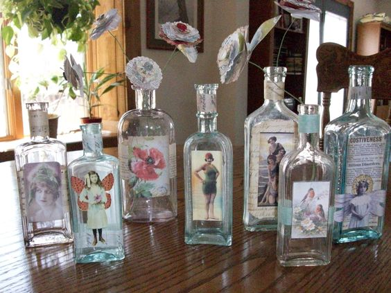 Altered bottles with vintage prints and paper flowers