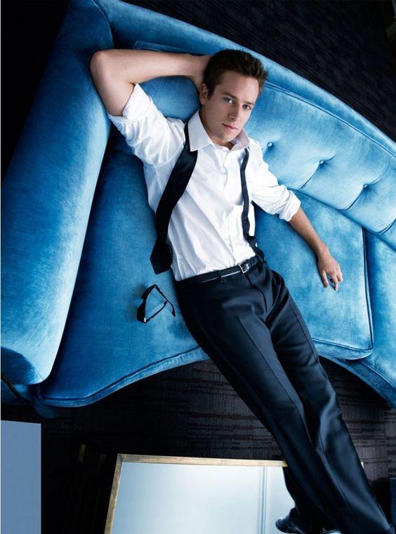 Armie Hammer: blue steel on a blue sofa