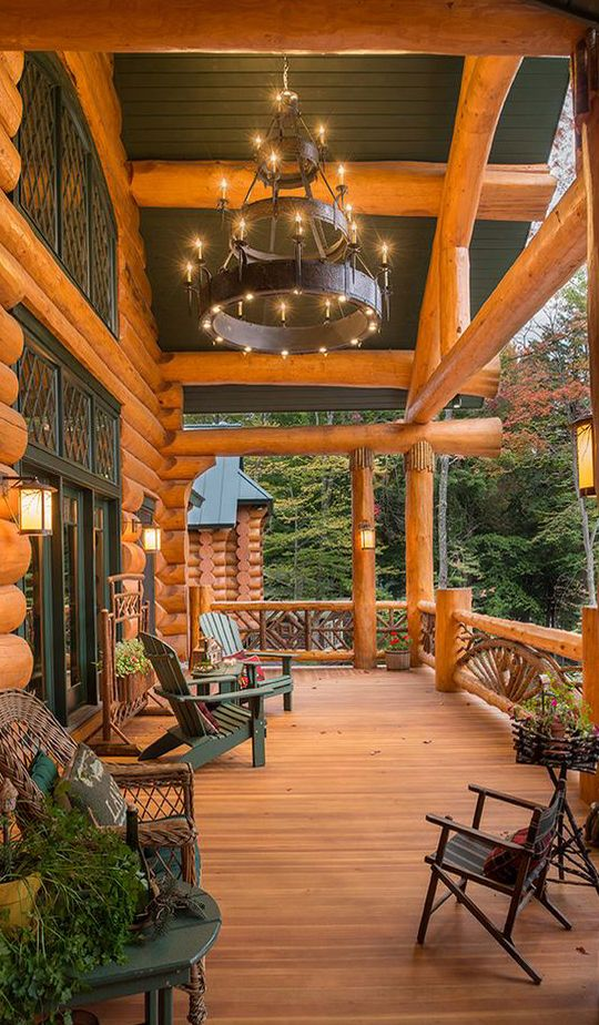 What a stunning porch i love the chandelier what a Log cabin chandelier