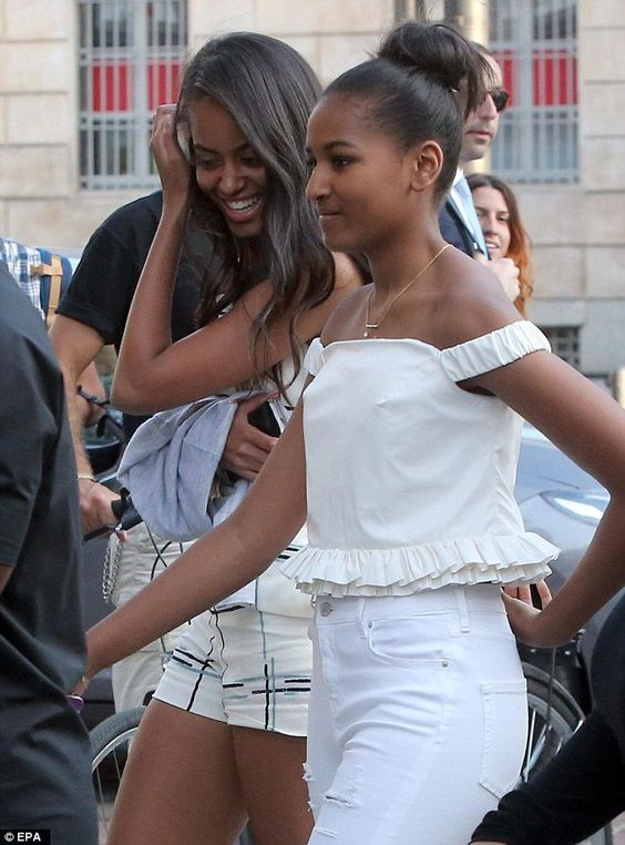 Malia and Sasha Obama. Growing up before our eyes. Love this picture because Malia is smiling!