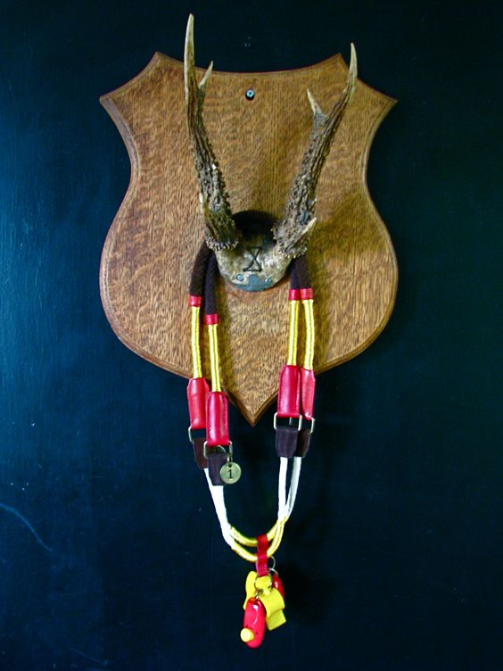 Display idea for Agility Necklace or Park Bag Necklace using antique horn rack.
