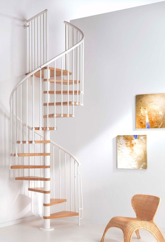 #Escalera de #caracol que se fusiona a la perfección con la decoración…