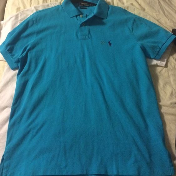 Polo Ralph Lauren polo shirt Polo Ralph Lauren polo shirt in blue. Men's Large, pretty much brand new. Polo by Ralph Lauren Tops Tees - Short Sleeve