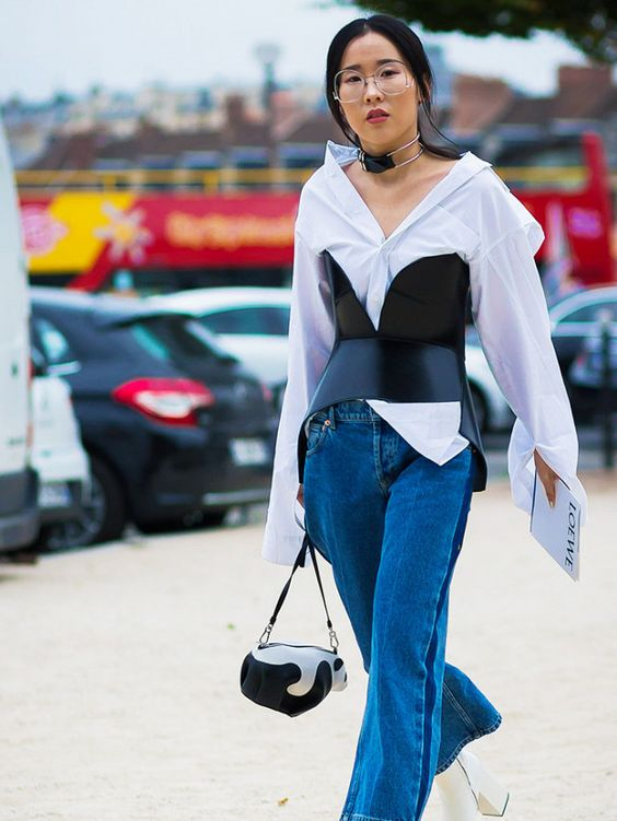 Style Notes: You do have to admit a layered corset or corset-belt does wonderful things to a plain shirt. After all, it is theaccessorising piece du jour.