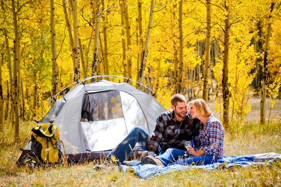 Camping engagement session #engagement #elevatephotography #baseball #coloradoengagementphotographer #camp #camping #tent #fall #aspens #creativeengagement  photo of Elevate Photography