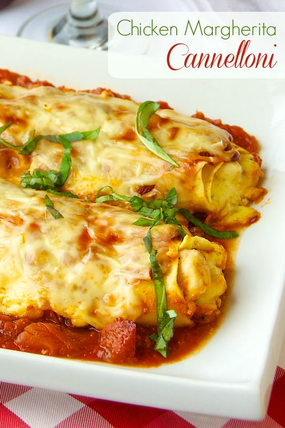 Chicken Cannelloni Margherita - Cheesy pasta rolls baked on a bed of ...