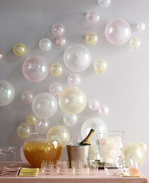 balloons blown up to different sizes and just taped to the wall....great for birthday parties!