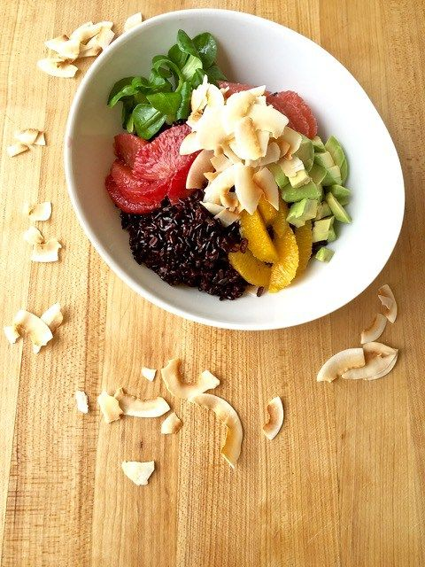 A simple recipe for a tropical coconut, citrus, and avocado rice bowl with healthy black rice that tastes just like vacation! | Tasting Everything