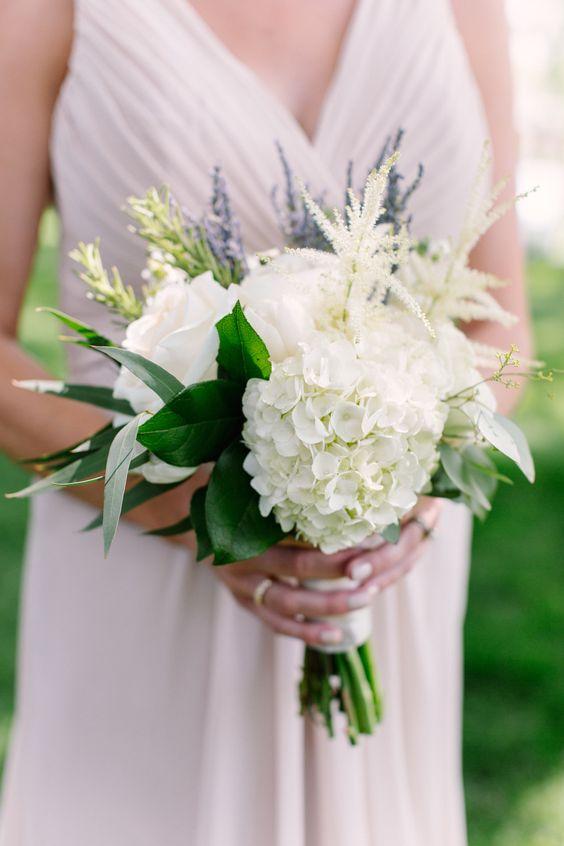 Gorgeous garden bouquet: http://www.stylemepretty.com/2015/03/17/traditionally-elegant-grove-wedding/ | Photography: m three studio - www.mthreestudio.com