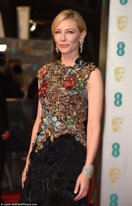 Lovely look: The 46-year-old star wowed in a black gown which had a floral top-section wit...