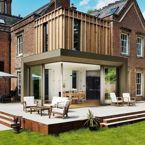 Traditional British Home in Brick Gets Fabulous Modern Extensions in Wood