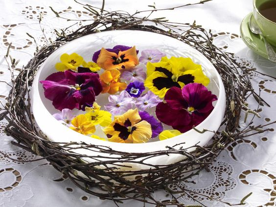pansy blossoms floating in a glass bowl + wreath...
