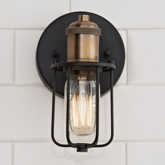 This bold industrial look has lots of style with a warehouse-inspired cage shade in Matte Black and flashy Gold socket. The effect is elevated by the 360 degree adjustability of the lamps. Can be wall or ceiling mounted.