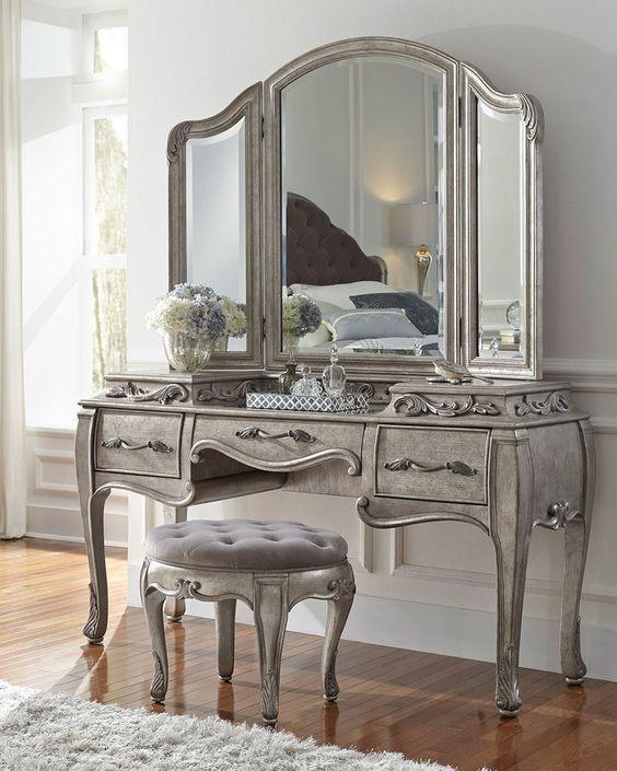 """<ul> <li>Vanity with French-influenced decorative motifs.</li> <li>Rubberwood frame.</li> <li>Aged-silver patina finish.</li> <li>Three drawers.</li> <li>62""""W x 20.5""""D x 34""""T.</li> <li>Imported.</li> </ul>"""