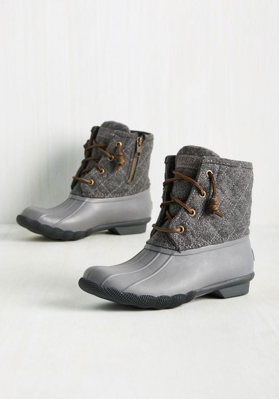 When the weather gets chilly, treat your toes to these grey duck boots from Sperry! This classic style touts leather laces, quilted wool uppers, and rubber bases and soles, assuring that your feet are warm, dry, and totally fly, no matter what Mother Nature has to say about it!