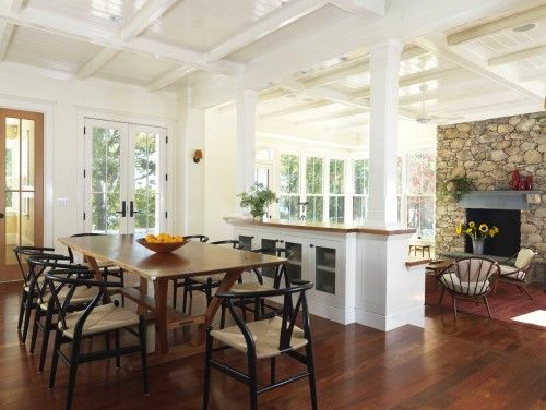 Open Concept Dining Room With Coffered Ceilings Divider And Stone Fireplace Focal Point