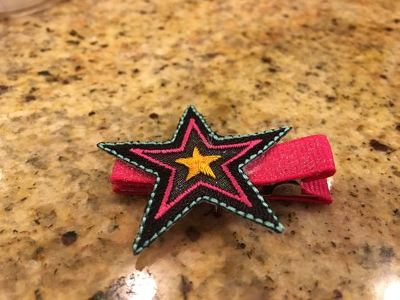 Sparkly star hair clip - clip also covered with sparkly bright pink ribbon. Includes non slip material inside clip.
