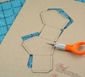 I printed my template directly onto our Classic Kraft cardstock. I used a ruler and a craft knife to trim out the template using my Scor-Mat.