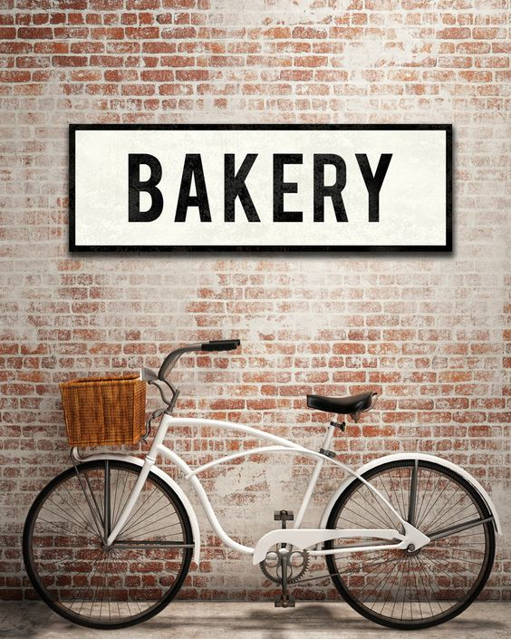 """THIS VINTAGE inspired Bakery Sign is reminiscent of old advertising signs and adds a touch of warmth to your kitchen or dining room. Available in 2 sizes, each sign is made to order and has a subtle aging process for a vintage look (see photo 3). You'll appreciate the authentic design details and gently worn letters.  Looking for a different word? You can replace BAKERY with a word of your own with up to 10 characters. Please leave a note for me in """"Note to TransitDesign"""" during checkout…"""