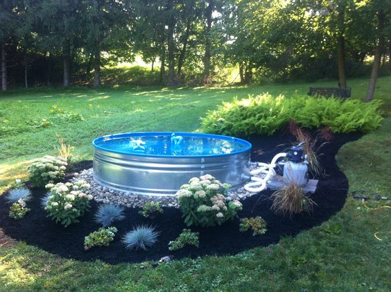 Stock tank galvanized steel and mini pool on pinterest for Galvanized water trough swimming pool