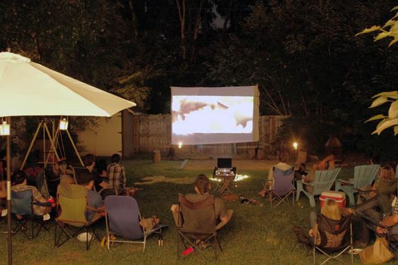 Backyard movie night. Totally doing this for the kiddies this summer!