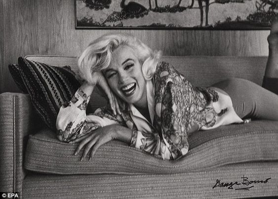Monroe, by now a superstar, pictured relaxing at home in a shot from 1962 taken by photographer George Barris