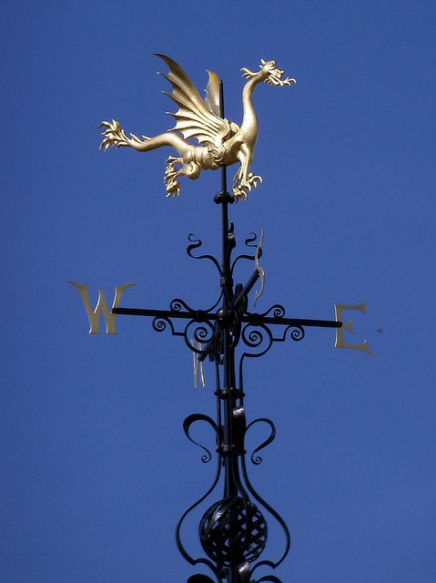 Dragon weathervane atop the clock tower of the Sir John Bennett Shop at Greenfield Village in Dearborn, Michigan