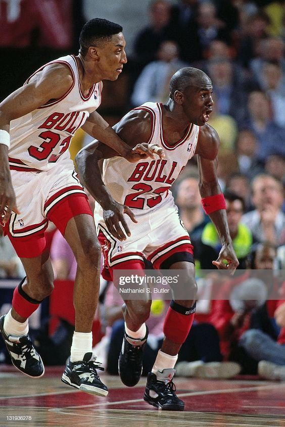 Michael Jordan And Scottie Pippen Of The Chicago Bulls In Action Michael Jordan Basketball Michael Jordan Michael Jordan Scottie Pippen