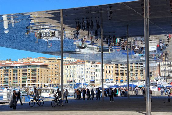 The Vieux port, Marseille, from the sophisticated to the sublime. From restaurants that spill onto the esplanade, quirky shops and places to entice you to part with your Euros to fishermen selling fresh seafood on the quayside and the fabulous Miroir Ombriere, mirrored shade designed by Norman Foster.