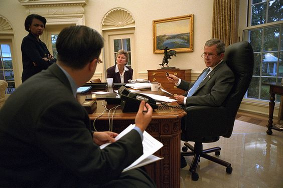 President George W. Bush prepares for his Address to the Nation with National Security Adviser Condoleezza Rice, speechwriter Mike Gerson, and Presidential Counselor Karen Hughes.