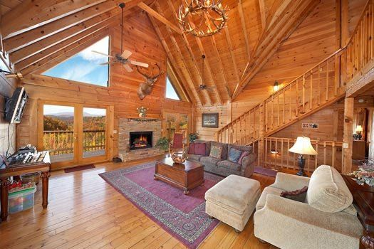 Grand Living Room On The Main Floor With Stone Fireplace At Big Bear Lodge A 7 Bedroom Cabin Rental Located In Big Bear Lodge Big Bear Cabin Gatlinburg Cabins
