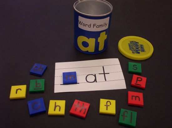 Word Family Cans - This center will need small Pringles cans for every word family. Cover the cans with contact paper and write the word family on the outside. In each can, put the ending rime written on paper and letter tiles that can be the onset in that word family. I use blank one inch tiles and I write the letters on them with a Sharpie marker. The children take a can and write all of the words in that word family that they can build with the tiles.