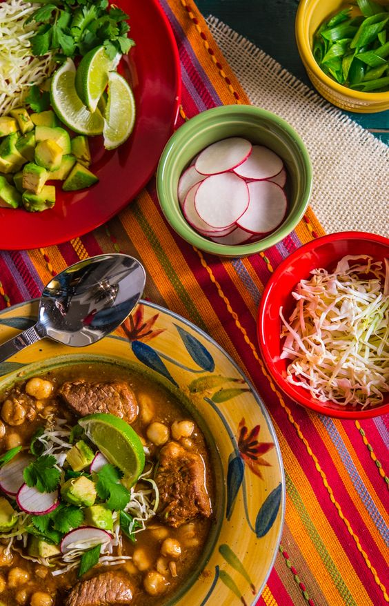 Authentic Mexican Posole - pork stew with hominy served with fresh garnishes.