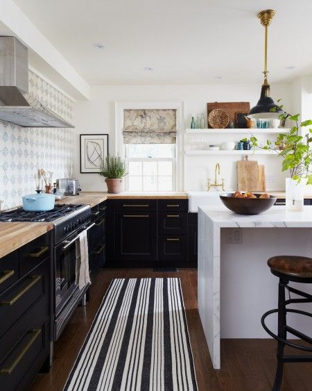 Love everything about this kitchen! Ikea Ramsjo black-brown cabinets - although look black here. Photo Gallery: Budget Kitchen Decorating | House Home: