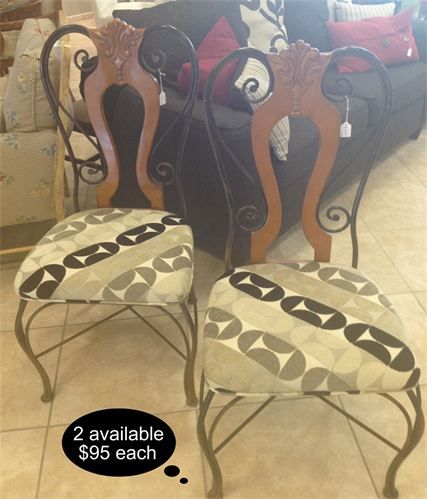 Contemporary sleek accents and upholstery define these iron and wood chairs. 2 available    Yesterdays Treasures Consignment  5829 Lone Tree Way Suite J  Antioch, CA 94531  925.233.4547  www.Yesterdayststore.com  Info@yesterdayststore.com