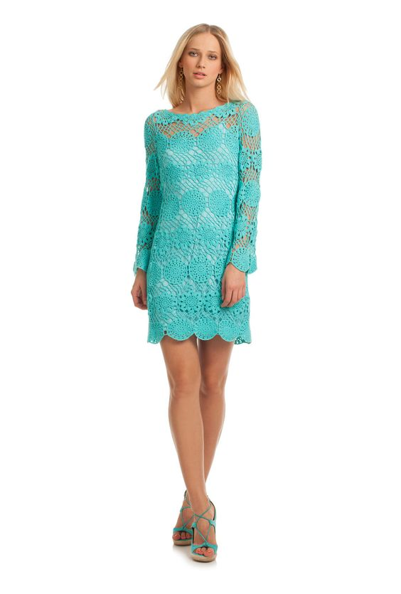 "DEVORA DRESS - TrinaTurk The perfect way to unleash your bohemian side, the 100% cotton Devora Dress is what free spirited summer style is all about. In all over hand crochet, this fitted sheath is sexy, cool and totally eye catching.  37"" Length Comes with slip Pullover styling 100% Pima Cotton"