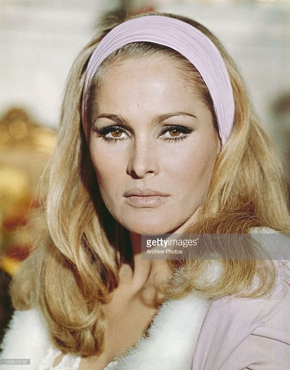 Photo d'actualité : Actress Ursula Andress wearing a hairband with...