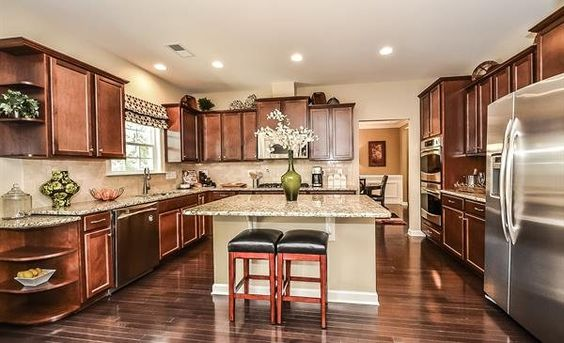 Harrison kitchen from Lennar Charlotte - we love the rich wood cabinets and floors!! What do you think?